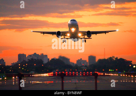 jet commercial airplane taking off the Jorge Newbery Airport, at sunset. - Stock Photo