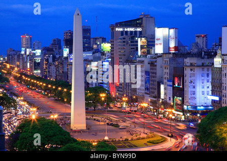 9 de Julio Ave. aerial view, and Obelisk (obelisco) and car lights traces, at twilight. Buenos Aires, Argentina, - Stock Photo