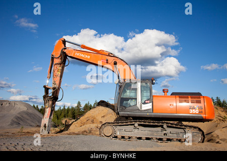 Hitachi ZAxis 350 lc excavator equipped with hydraulic rock breaker for rock quarry usage , Finland - Stock Photo