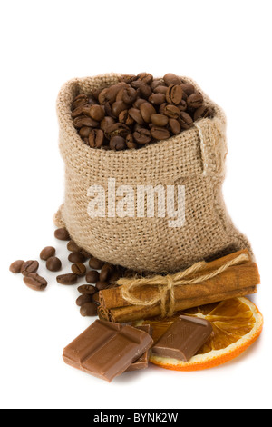 Coffee beans in canvas sack with cinnamon, chocolate and dried orange slice - Stock Photo