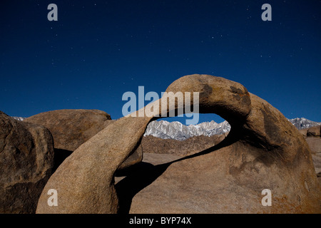 Mobius Arch, Moon lit landscape in the Alabama Hills, Mt. Whitney and Eastern Sierras - Stock Photo