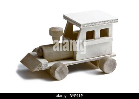 Wooden toy train with wheels on white background - Stock Photo