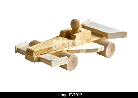Wooden toy race car with driver on white background - Stock Photo