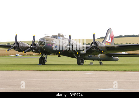 Boeing B-17G Flying Fortress 'Pink Lady' on the flightline at Duxford airfield - Stock Photo