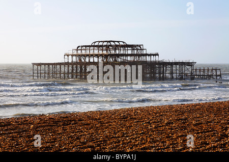 The coast and West Pier at Brighton, East Sussex, England - Stock Photo