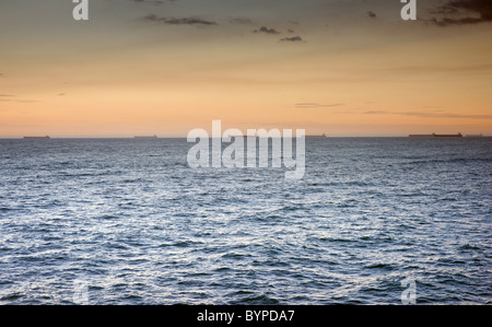 beautiful ocean waves at sunset newcastle australia - Stock Photo