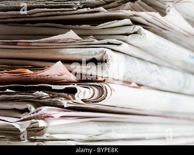 old newspapers in stack. Copy space - Stock Photo