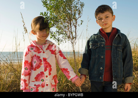 Young boy and girl holding hands, portrait