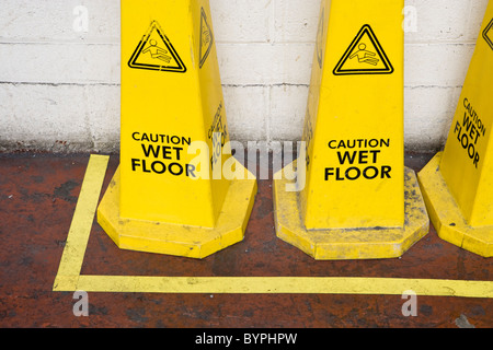 Caution wet floor signs - Stock Photo