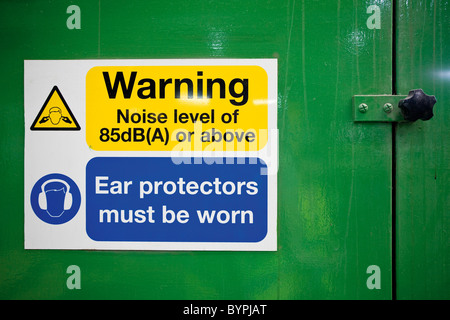 Sign warning of high levels of noise and the need to wear ear protectors - Stock Photo