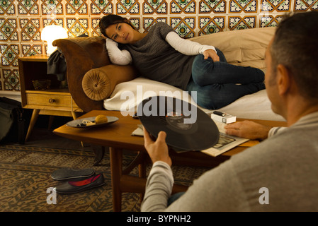 Couple relaxing in living room - Stock Photo