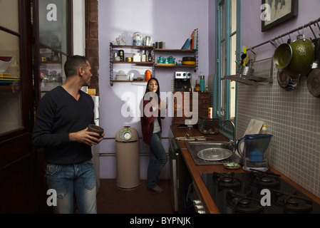 Couple in kitchen together - Stock Photo