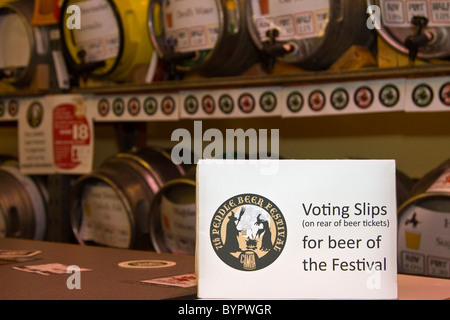 Racking and Stillage _ Voting slips for the 7th Pendle Beer Festival. Colne, Lancashire, UK - Stock Photo