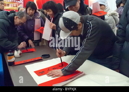 New Year's greetings are written in Chinatown in New York on January 29, 2011 at the Lunar New Year Flower Market - Stock Photo