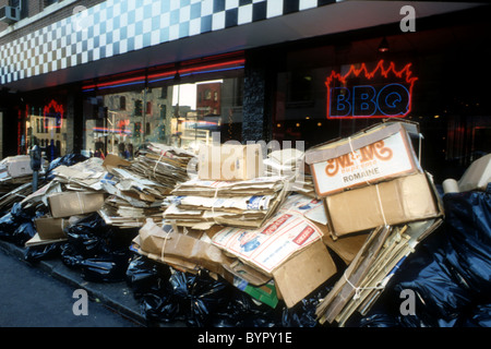 Bags of trash and recyclables await pick-up in the Greenwich Village neighborhood of New York in 1989. (© Richard - Stock Photo