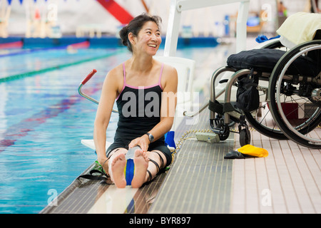 A wheelchair bound disabled person preparing to go - Swimming pool wheelchair lift law ...