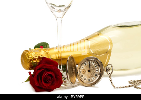wet red rose under a champagne bottle with a old pocket watch and a empty champagne glass on white background - Stock Photo