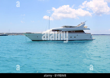 luxury yacht in turquoise Illetes Formentera mediterranean sea Balearic Islands - Stock Photo
