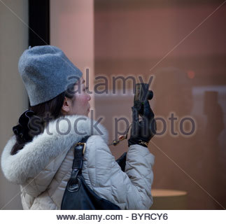 Person taking pictures with s digital camera - Paris France - Stock Photo