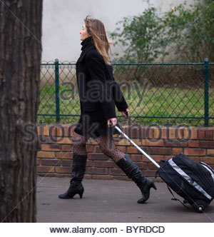 Woman walking along a street in Central Paris France - Stock Photo