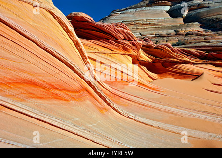 Colorful waves of sandstone in Arizona's Coyote Buttes North Wilderness and Vermilion Cliffs National Monument. - Stock Photo