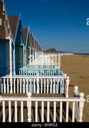 Row of Colourful Beach huts along the Beach - Stock Photo