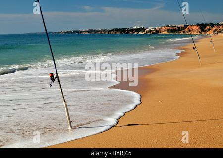 Portugal, Algarve: Fishing rods at Praia da Falesia in Albufeira - Stock Photo