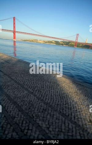 Abstract view of the Ponte de 25 Abril bridge crossing the Rio Tejo, Lisbon, Portugal. - Stock Photo