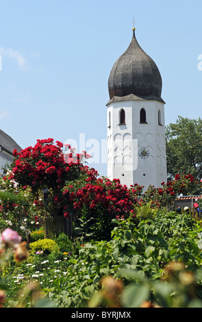 The bell tower of Frauenchiemsee island is a very well known landmark in the Chiemsee - Stock Photo