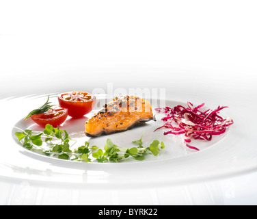 salad plate fresh mixed leaves fish salmon smoked salmon praline peace Praline of salmon pepper peppered ruccola - Stock Photo