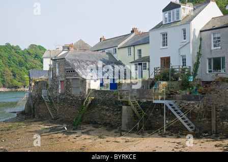 Flights of steps leading from the shore up to cottages and old buildings at low tide River Fowey at Fowey south - Stock Photo