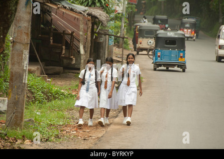 Sri Lanka. Typical views along Route A1 between Colombo and Kandy. Local schoolgirls in uniform. - Stock Photo
