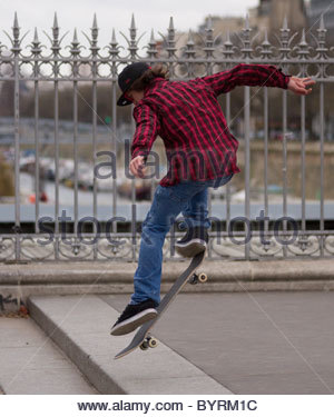 Teenager skateboarding in Paris France - Stock Photo