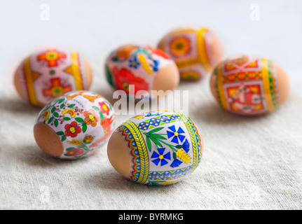 Painted Colorful Easter Eggs on Beige Huckaback Towel - Stock Photo