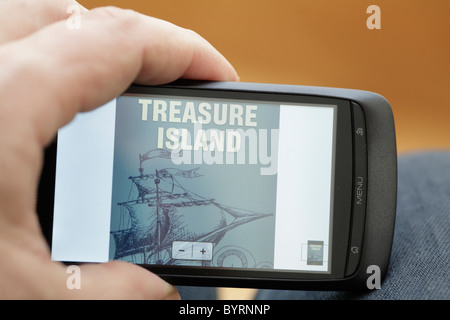 Kindle reader on a touchscreen Orange network San Francisco mobile phone android os smartphone Treasure Island cover - Stock Photo