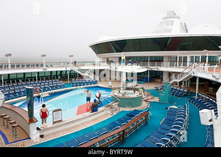 Almost empty deck of Royal Caribbean's Jewel of the Seas cruise ship on a day with heavy fog - Stock Photo