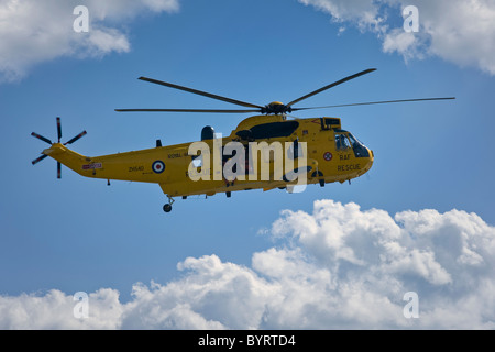 Yellow Air Sea Rescue Sea King Helicopter of 22 Squadron at Air show - Stock Photo