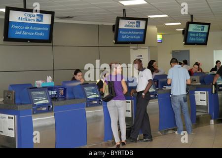 Panama City Panama Aeropuerto Tocumen airport PTY aviation terminal Copa Airlines carrier counter kiosk passenger - Stock Photo