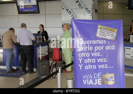 Panama City Panama Aeropuerto Tocumen airport PTY aviation terminal Copa Airlines carrier counter passenger man - Stock Photo