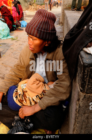 homeless mother and child begging ,peoples lives ( the nepalis ) , life in kathmandu , kathmandu street life , nepal - Stock Photo