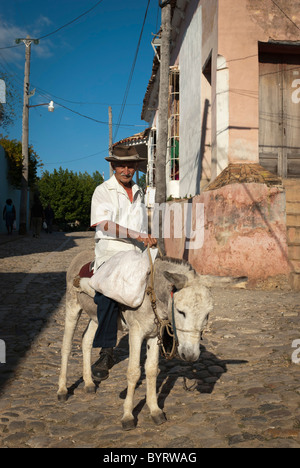 Old man with hat on his donkey , Trinidad, Sancti Spiritus, Cuba. - Stock Photo