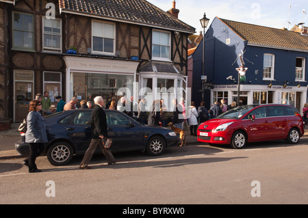 People queue outside The Golden Galleon fish and chip shop at Aldeburgh , Suffolk , England , Britain , Uk - Stock Photo