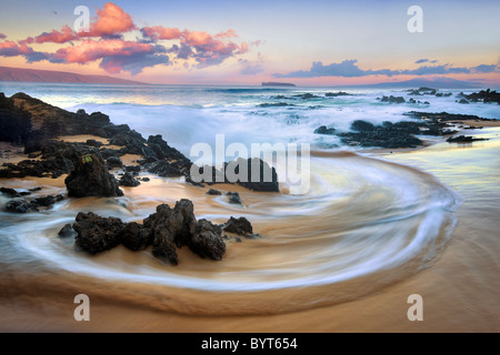 Wave pattern and sunrise clouds. Maui, Hawaii - Stock Photo