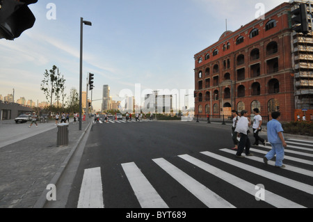 People using a zebra crossing in Shanghai - Stock Photo