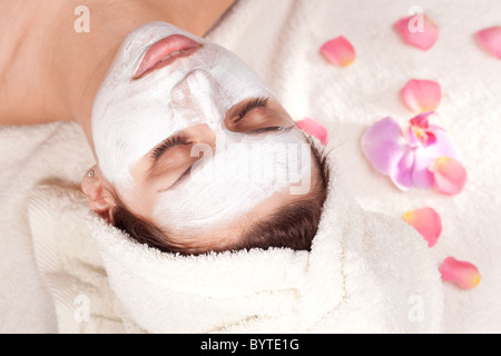 Young woman getting spa procedures. - Stock Photo