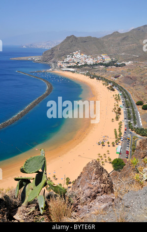 Aerial view the famous beach of Teresitas at Tenerife Canary Islands with the village of San Andres in the background - Stock Photo