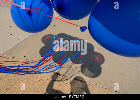 Holding Blue Balloons For A Childs Birthday Party In Manhattan New York City USA