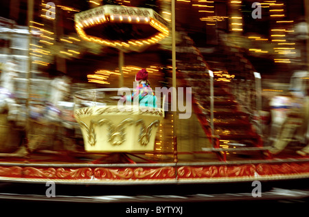 Merry-go-round at the Christmas Market at Römerberg in the German city of Frankfurt. - Stock Photo