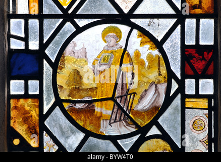 Mediaeval stained glass in St. Laurence Church, Diddington, Cambridgeshire, England, UK - Stock Photo