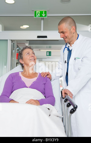Doctor caring for elderly woman - Stock Photo